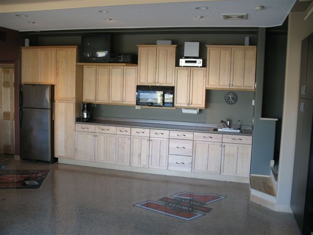 A garage floor done right for Kitchen units in garage